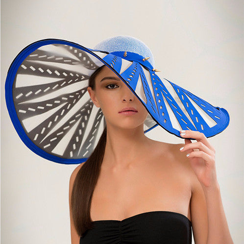 Manipur - Cobalt laser-cut neoprene and crinoline brim sunhat with brass spike trim band, and french net and silk crown. Wear this to the beach or to the races, either way you're making an entrance.