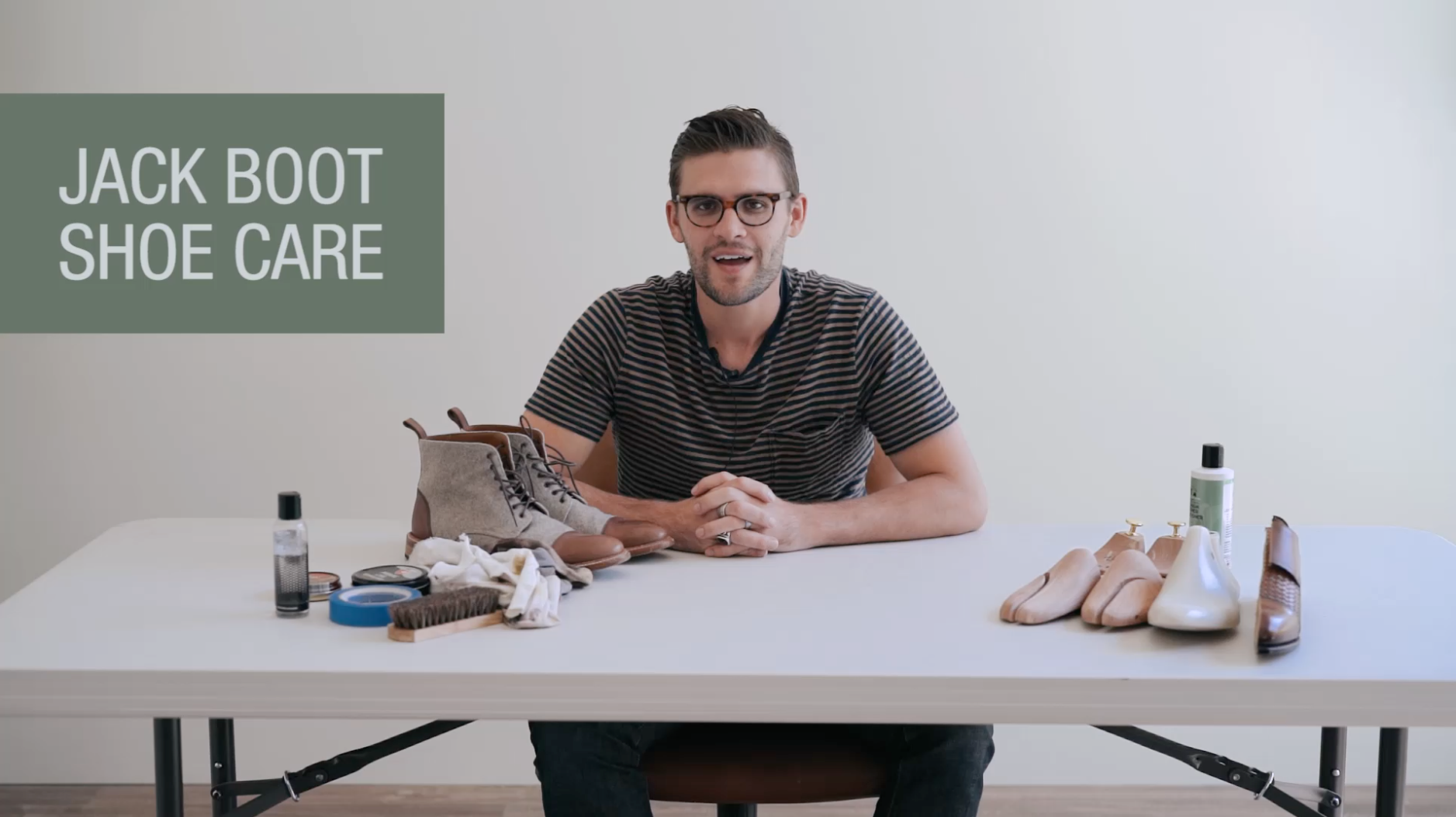 image of our founder and CEO at a table demonstrating boot care
