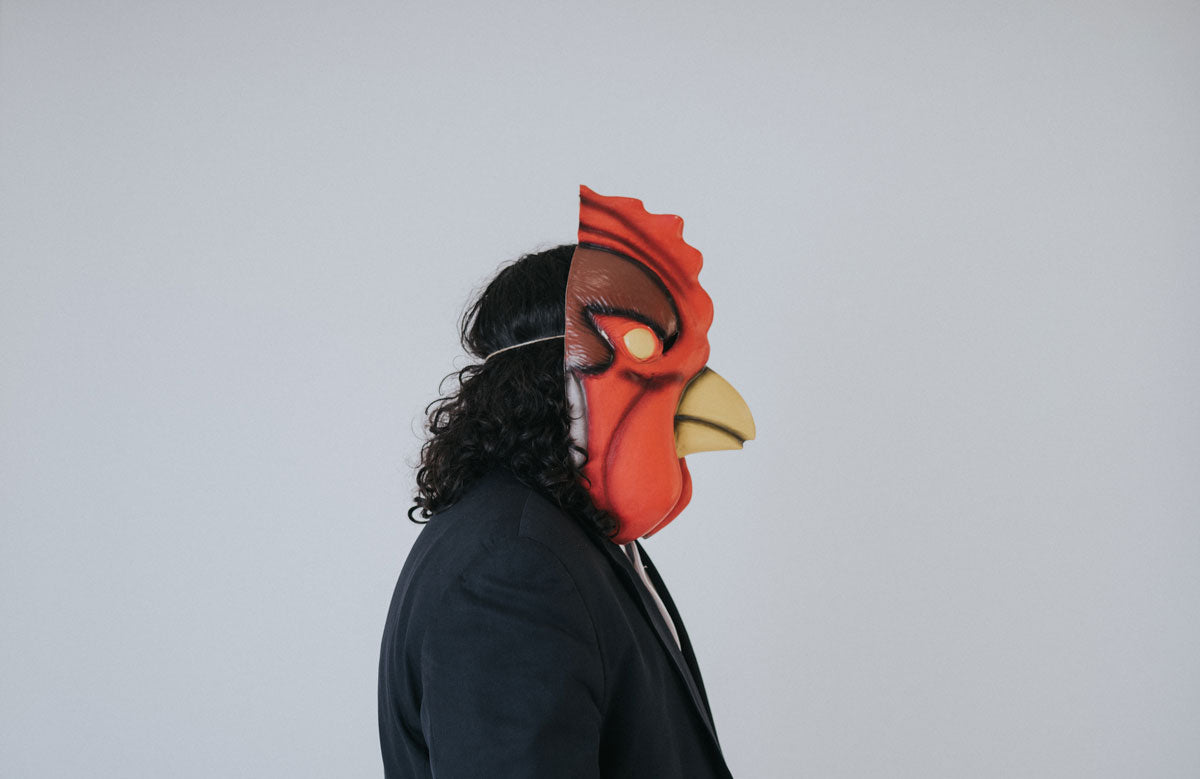 photo of musician brock berrigan wearing a rooster mask