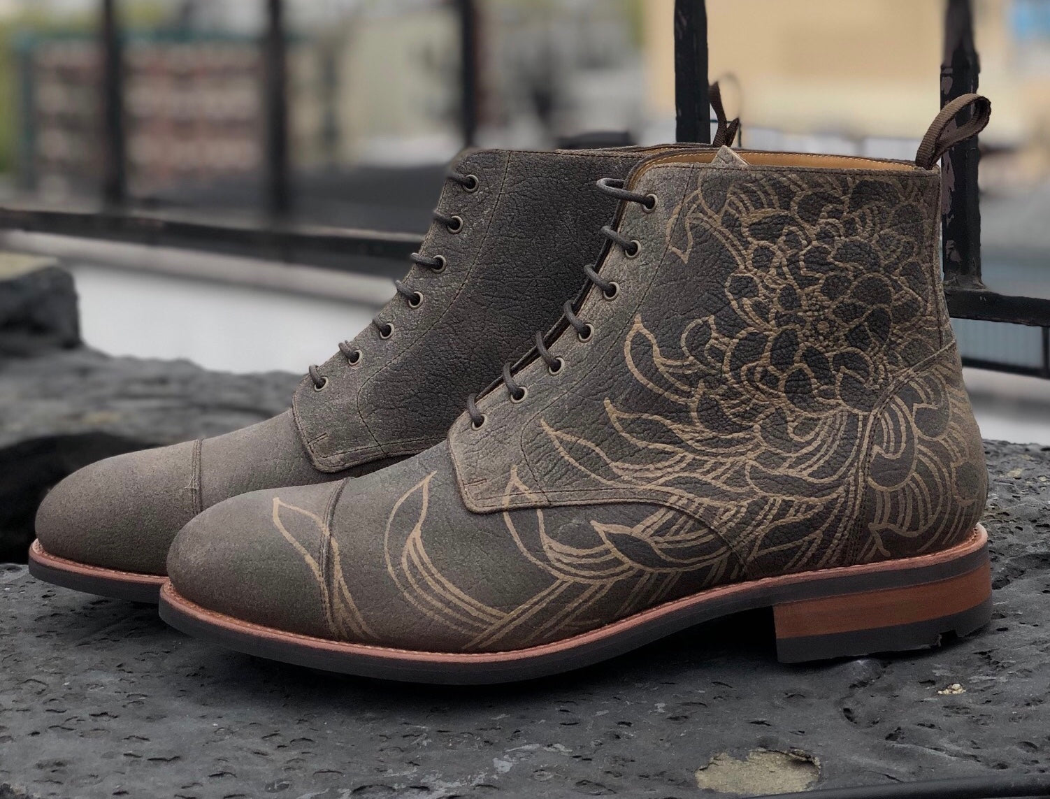 dragon boots in london fog with floral patten etched into the leather