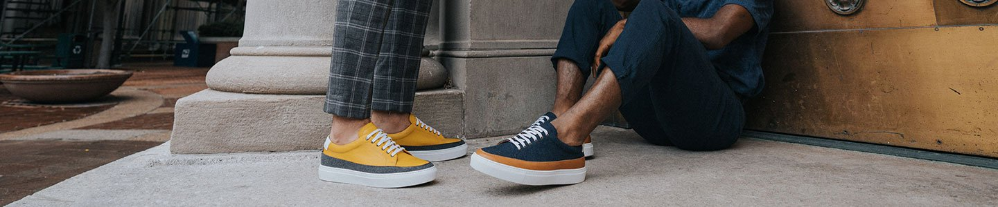 models ankle down in the fifth ave yellow and fifth ave navy on concrete floor