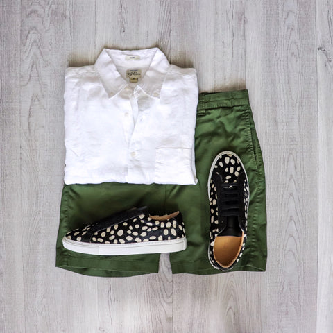 image of white shirt with green shorts and the sneaker in pony