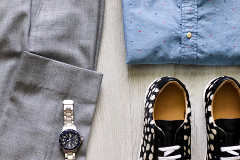 photo of blue button up, gray slacks, sneaker in pony