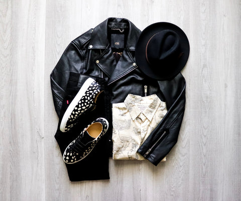 image of leather black jacket, white button up, black denim, and the sneaker in pony