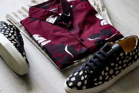 photo of red Hawaiian themed shirt, grey and white stripe pants and the sneaker in pony