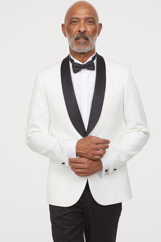 male model in tuxedo (white jacket + black pants)
