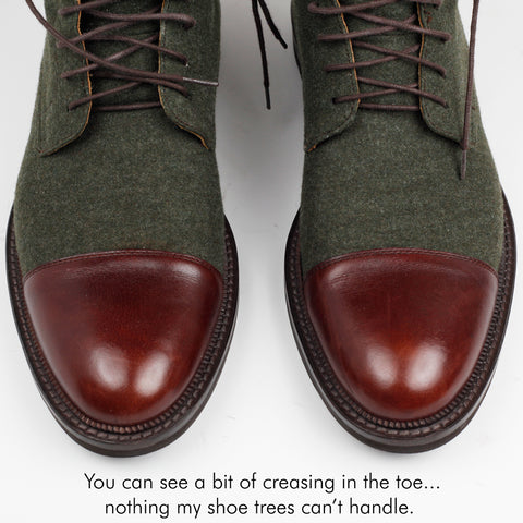 "close up of jack boots with text ""you can see a bit of creasing in the toe... nothing my shoe trees can't handle"""