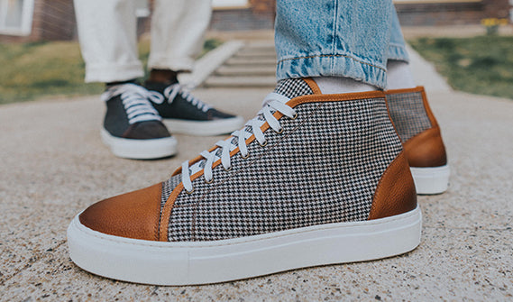 The Jack Sneaker Mid in Honey and the Jack Sneaker Grey/Oxblood on model lifestyle image