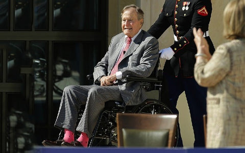George W. Bush in pink trendy socks