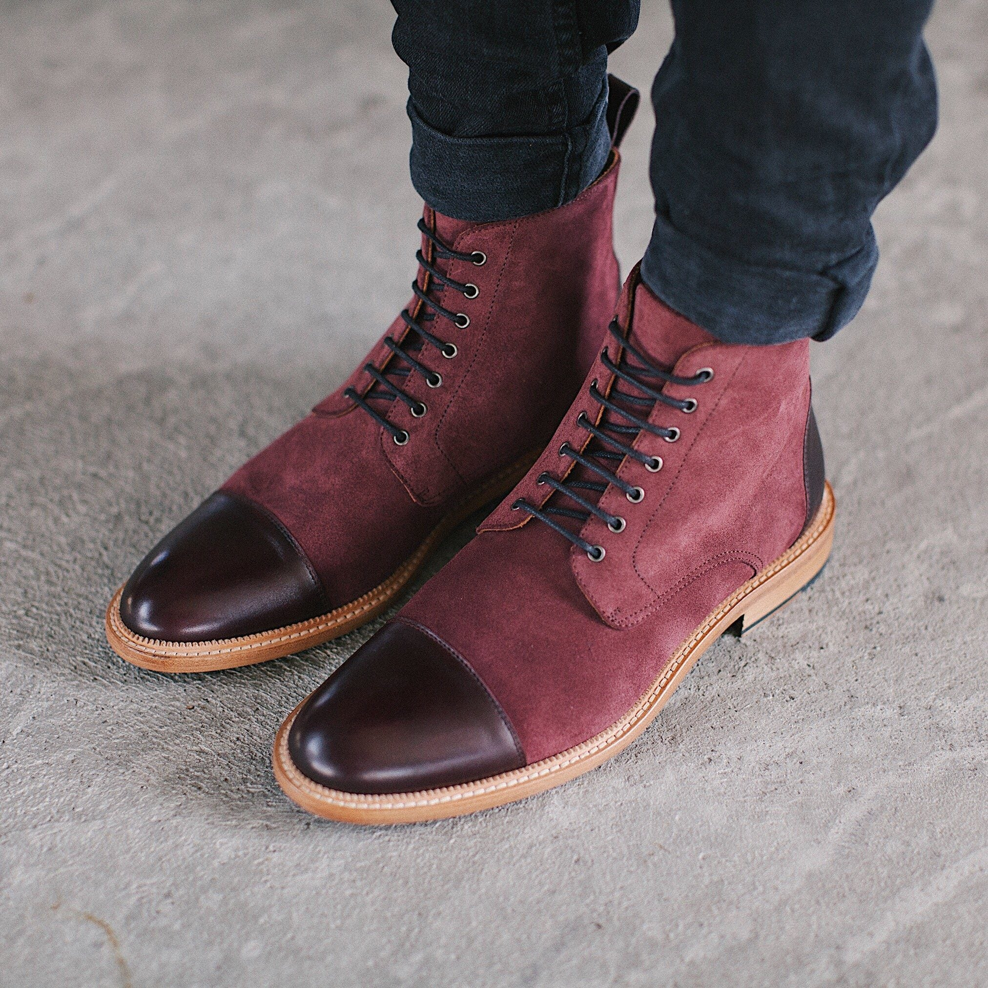 Model ankle down in dark denim wearing Troy Boot Oxblood