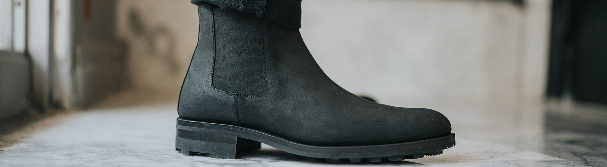 The Drake Boot in Midnight on model