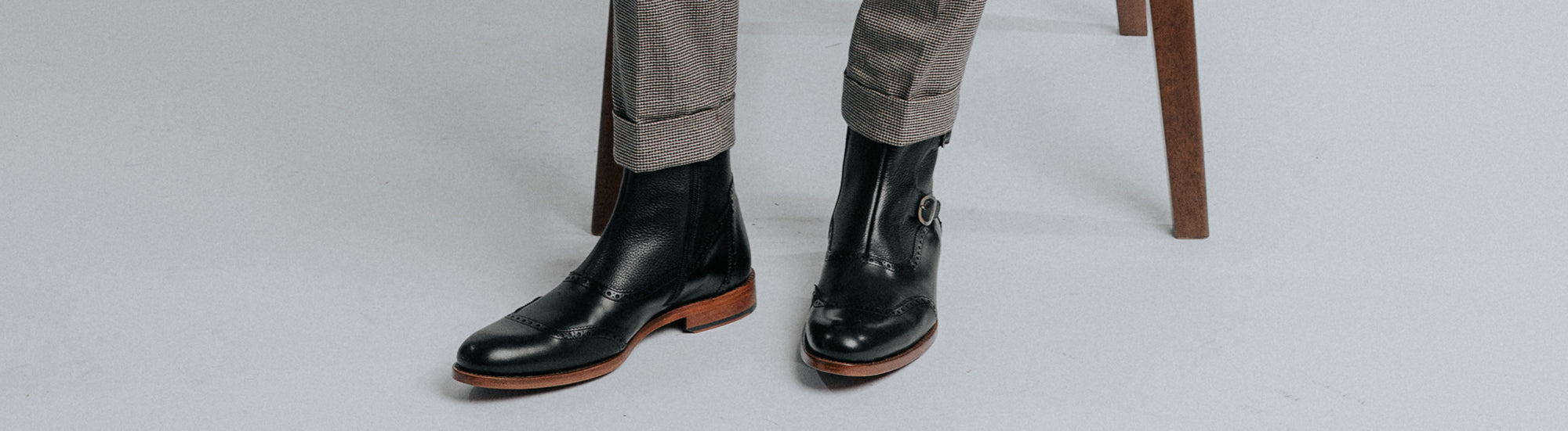 The Dustin Boot in Black on model wearing checkered pants