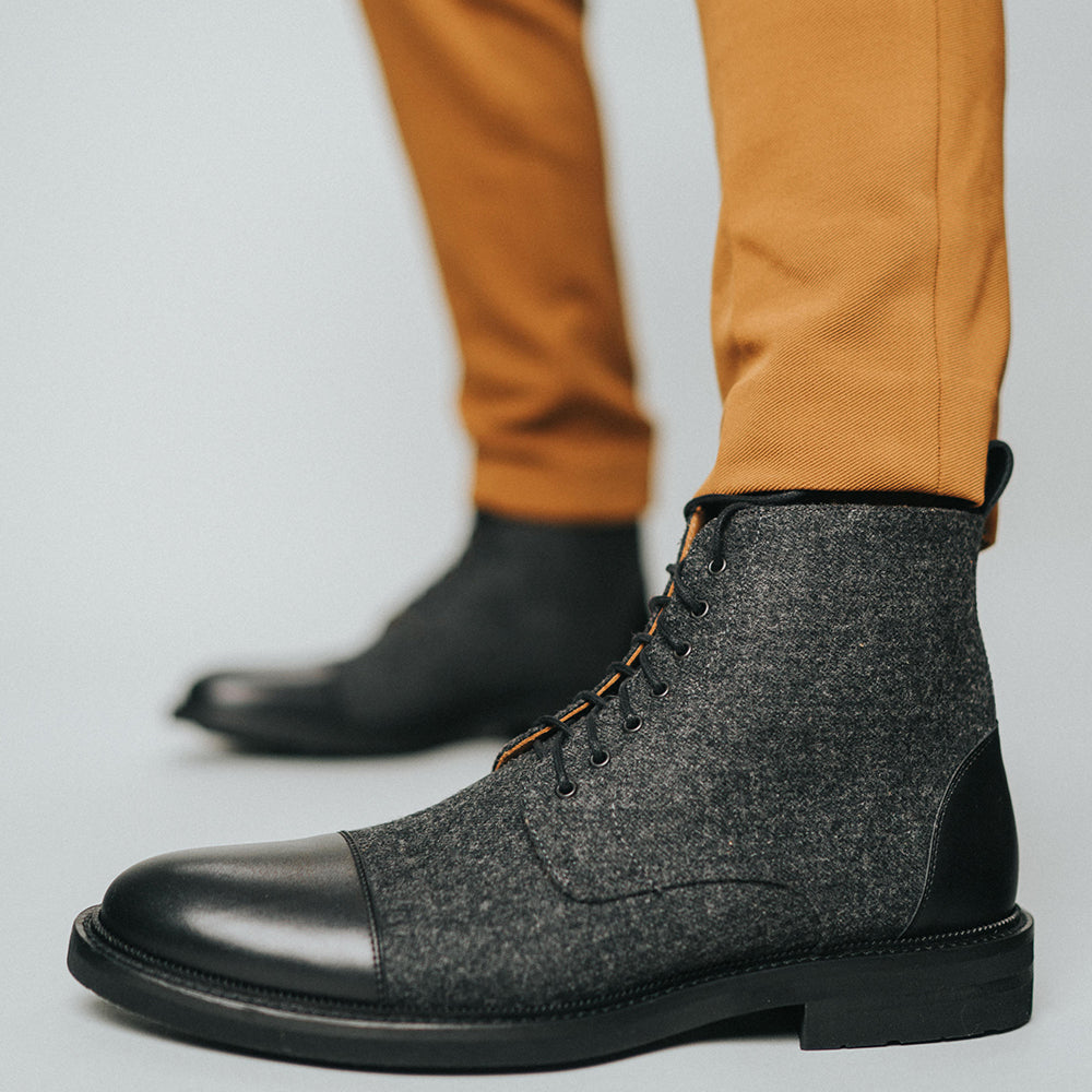 The Jack Boot in Black on model wearing tan pants