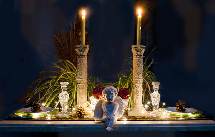 Photo of several Caproni casts displayed together on a table with lit candles