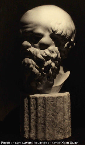 Photo of cast drawing of Socrates bust on a black background