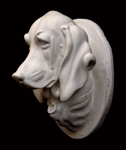 Photo of a plaster cast original Caproni sculpture of a portrait head of a pointer dog on a black background