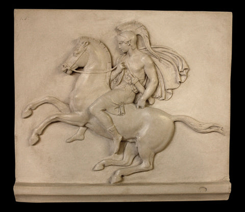 Photo of plaster cast sculpture relief of man with helmet and drapery on a rearing horse