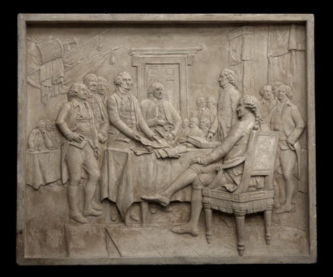 Photo of plaster cast sculpture relief of the signing of the American Declaration of Independence depicting John Hancock, Thomas Jefferson, John Adams, and Benjamin Franklin