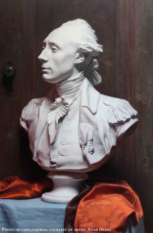 Photo of Cast Painting of Plaster Cast of Lafayette on a blue table with a red cloth and dark wooden background