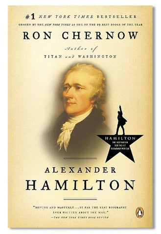 Photo of antique yellow book cover with portrait of man and logo of Hamilton musical