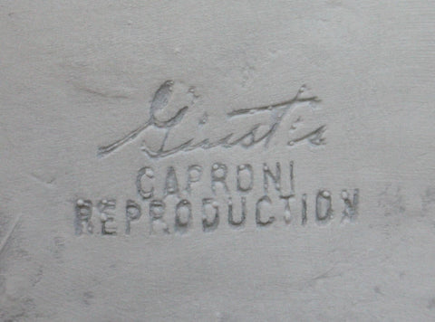 Photo of company stamp in a plaster cast sculpture