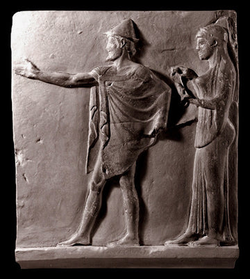 photo of plaster cast sculpture relief of two figures walking to the left, the male reaching out his right hand and the female behind him