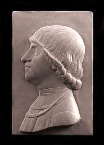 tinted photo of plaster cast relief sculpture of young male in profile with shoulder-length hair on a black background