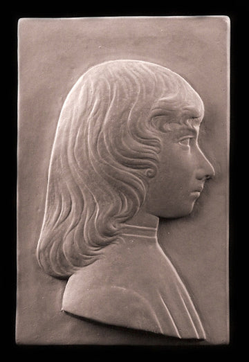 tinted photo of plaster cast relief sculpture of young female in profile with long hair on a black background