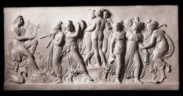 Photo with black background of plaster cast sculpture relief of nude and clothed females dancing and playing instruments and one male playing a lyre