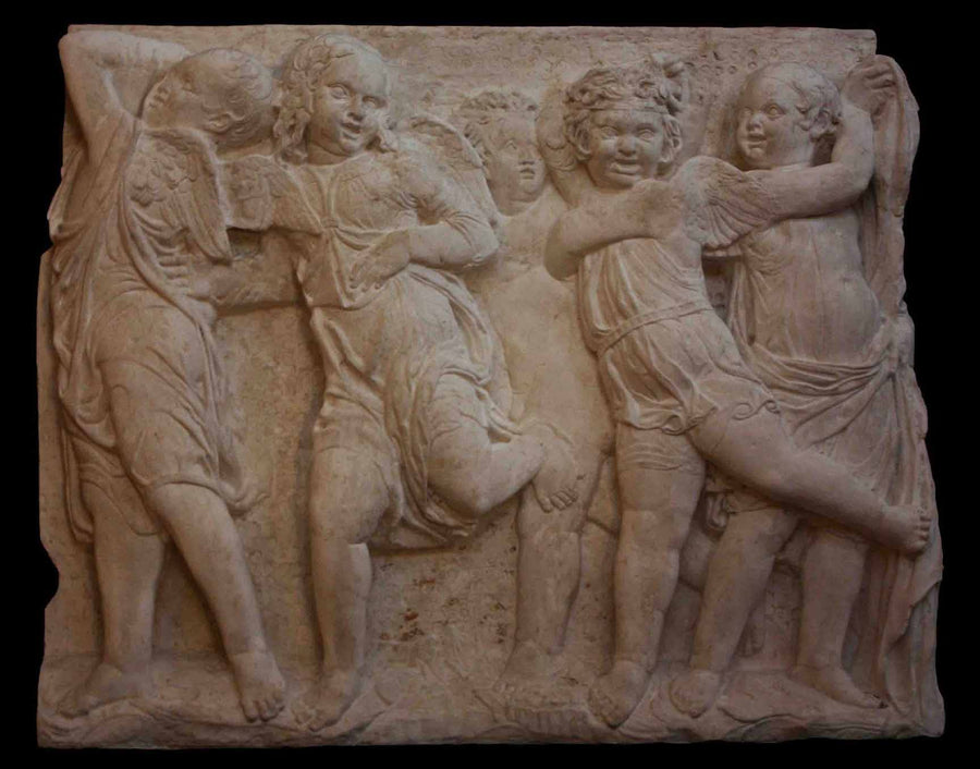 photo of plaster cast relief of children dancing with black background