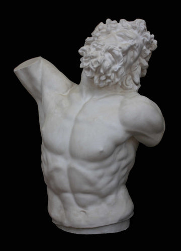 photo with black background of plaster cast of sculpted male torso and head with curly hair and beard