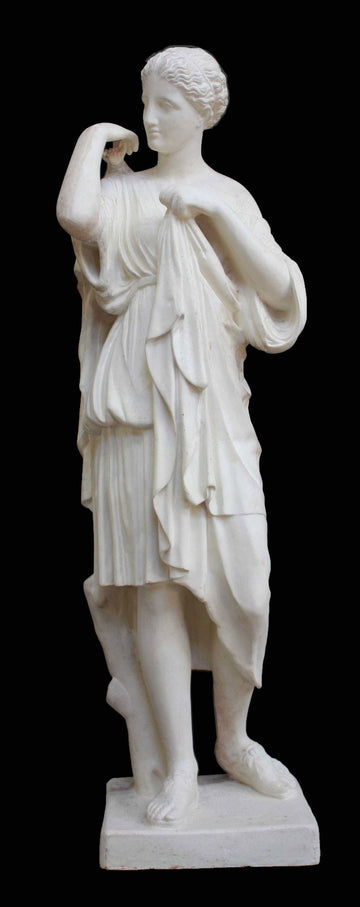 photo with black background of plaster cast of female figure with robes about to clasp two pieces together at proper right shoulder