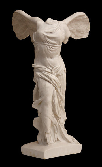photo of plaster cast sculpture of winged, headless female figure with flowing drapery on a black background