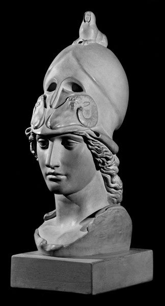 photo of plaster cast sculpture bust of female head, namely the goddess Athena, with a helmet on a black background
