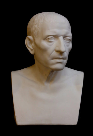 photo with black background of plaster cast sculpture of male head of Cicero with squared bust