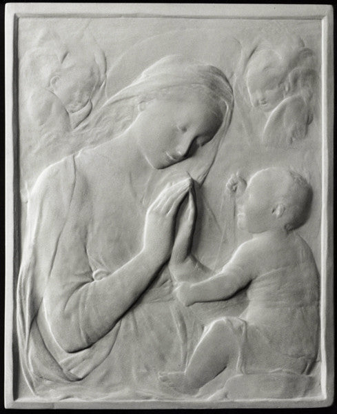 photo of plaster cast sculpture relief of the Madonna praying and looking at the baby Jesus and angels in the background