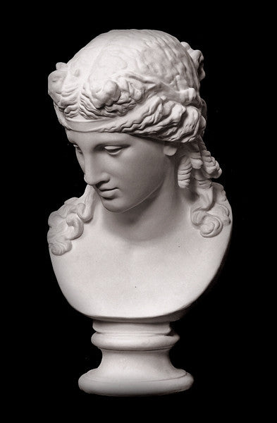 photo of plaster cast of sculpture bust of Ariadne or Bacchus with long, curly hair and head band on a black background