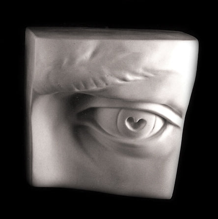 Photo plaster cast of an eye from a sculpture's head on a black background