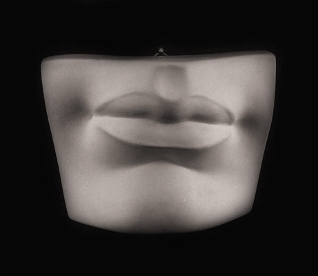 Photo plaster cast of a mouth from a sculpture's head on a black background