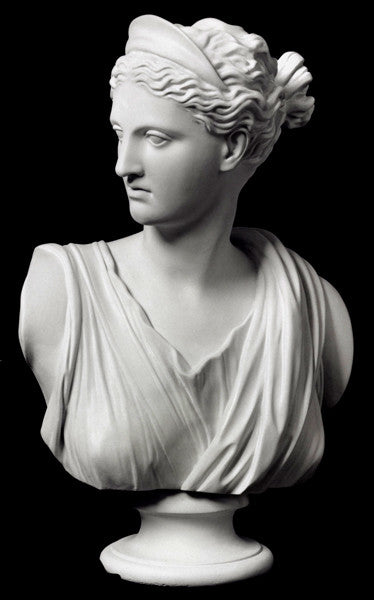 Photo with black background of white plaster cast of sculpture bust of female goddess Diana with drapery and crown and up-do