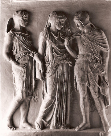 photo with gray background of plaster cast of ancient relief with three figures, namely Hades, Eurydice, and Orpheus