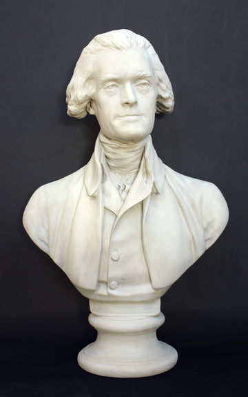 Photo of plaster cast bust sculpture of man with coat and neckerchief, namely Thomas Jefferson, with dark gray background