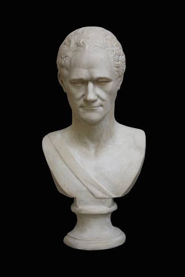 photo with black background of plaster cast bust of man