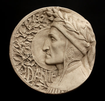 photo of plaster cast of small medallion with male portrait, namely Dante Alighieri, in profile and floral decoration on the left side curve and the word Dante, on black background