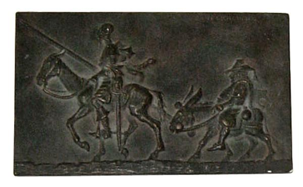 photo of bronzed plaster cast relief sculpture of two men riding horse and donkey all in profile