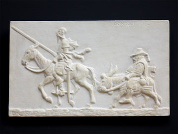 photo of plaster cast relief sculpture of two men riding horse and donkey all in profile with black background