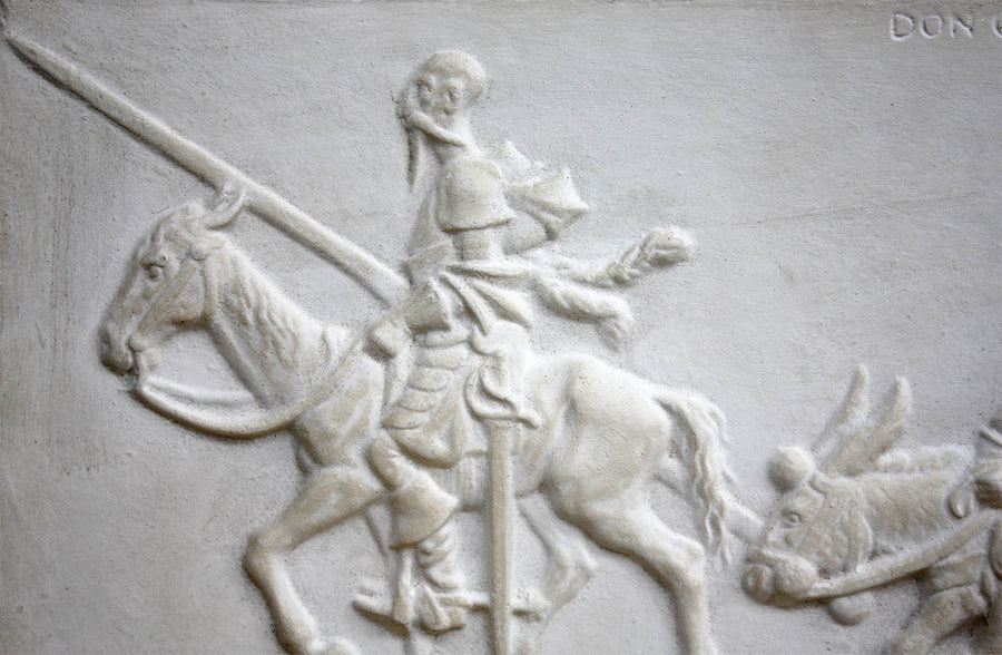 closeup photo of plaster cast relief sculpture of man riding horse in profile