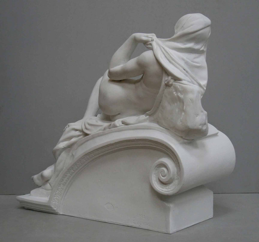 back view photo of plaster cast of reclining female nude with a gray background