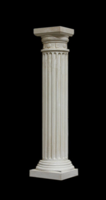photo with black background of plaster cast sculpture of Greek half column