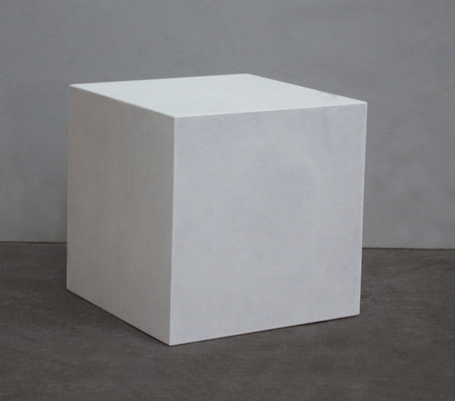 photo with gray background of plaster cast cube geometric shape